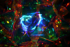 Psychedelic Christmas Ribbon. Close-up image of a translucent Christmas ribbon stock photo