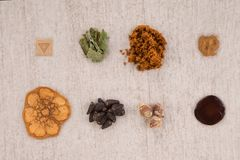Psychedelic compounds. Alternative medicine. Top view, knolling. Psychedelic compounds. LSD acid blotter, iboga root bark, syrian rue, ayahuasca, banisteriopsis royalty free stock image