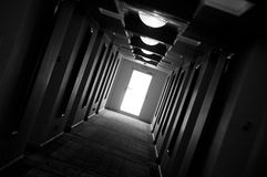 Haunted Corridor. A tilted photo of a psychedelic haunted corridor. There are repetitive doors and lights on the ceiling Stock Images