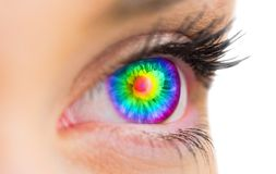 Psychedelic eye looking ahead on female face. Psychedelic eye looking ahead on white background royalty free stock photography