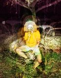 Psychedelic glitch horror skull mask man on abandoned car background royalty free stock photography