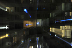 Psychedelic television. Building at night with its residents watching tv royalty free stock photos