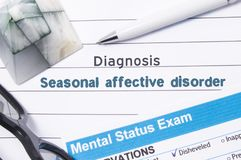 Psychiatric Diagnosis Seasonal Affective Disorder. Medical book or form with name of diagnosis Seasonal Affective Disorder is on t royalty free stock images
