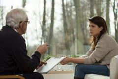 Psychiatris gives a diagnosis Stock Photo