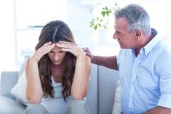 Psychiatrist advising pregenat woman in clinic. Psychiatrist advising to pregnant women while sitting in clinic stock image