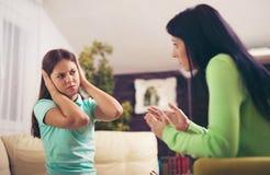 Psychiatrist diagnosing teenage girl with mental problem Stock Photography