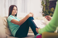 Psychiatrist diagnosing teenage girl with mental problem Stock Images