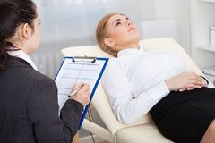 Psychiatrist examining patient Stock Images