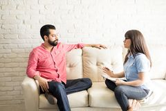 Psychiatrist explaining diagnosis and treatment to patient. Female psychiatrist explaining diagnosis and treatment to male patient during therapy in her office Royalty Free Stock Image