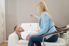 Psychiatrist Hypnotizing Patient. Female Psychiatrist Hypnotizing Patient Lying On Couch Stock Image