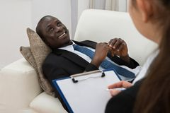 Psychiatrist Making Notes In Front Of Patient royalty free stock image