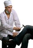 Psychiatrist & reflex hammer. The doctor investigates reflex of the nervous patient Royalty Free Stock Image