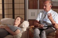 Psychiatrist talking to his patient Stock Photo