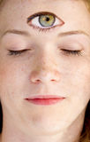Psychic face. Face of a woman with open eye in the forhead Royalty Free Stock Images