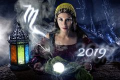 2019 Scorpio Predictions. Psychic or fortune teller with crystal ball and horoscope zodiac sign of Scorpio royalty free stock photography