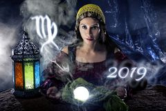 2019 Virgo Predictions. Psychic or fortune teller with crystal ball and horoscope zodiac sign of Virgo royalty free stock images