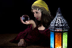 Psychic Fortune Teller. Psychic or diviner staring at a crystal ball to predict destiny or future.  Astrology. Fortune Teller Stock Image