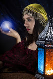 Psychic Fortune Teller. Psychic or diviner staring at a crystal ball to predict destiny or future.  Astrology. Fortune Teller Stock Images
