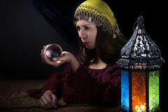 Psychic Fortune Teller. Psychic or diviner staring at a crystal ball to predict destiny or future.  Astrology. Fortune Teller Stock Photography