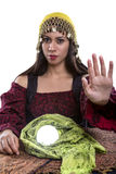 Psychic or Fortune Teller on White Background. Female psychic or fortune teller with her hands up telling viewer to stop or rejecting.  She is isolated on a Stock Photos