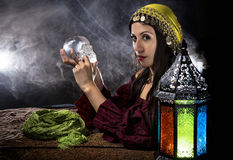 Psychic or Gypsy Halloween Costume. Female psychic or fortune teller holding a crystal skull trying to communicate with the dead Stock Image
