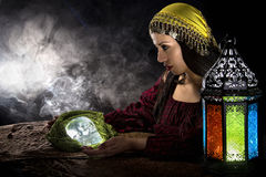 Psychic or Gypsy Halloween Costume. Female psychic or fortune teller holding a crystal skull trying to communicate with the dead Royalty Free Stock Photography