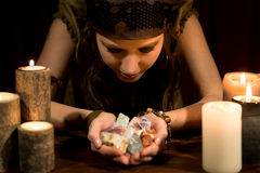 Psychic with a lots of healing stones. Young female psychic with a lots of healing stones Royalty Free Stock Photos