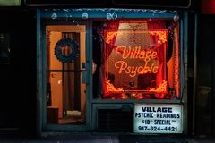 Psychic neon sign at night, in the East Village, Manhattan, New York City.  stock images