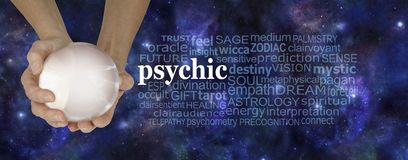 Psychic Powers Fortune Teller`s Word Cloud. Female hands holding a large crystal ball with a PSYCHIC word cloud to the right against a dark blue starry night sky stock photos