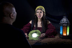 Psychic Reading. With a fortune teller and superstitious client. Astrology. Divination stock image