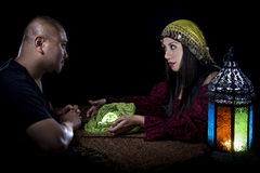 Psychic Reading. With a fortune teller and superstitious client. Astrology. Divination stock photography