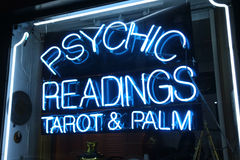 Psychic Readings. A neon sign that says Psychic Readings Tarot & Palm Royalty Free Stock Photos