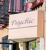 Psychic Sign. On a pink board in a street in NYC Stock Photography