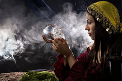 Psychic or a Spirit Medium. Female psychic or fortune teller holding a crystal skull trying to communicate with the dead Stock Images