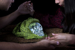 Psychic or a Spirit Medium. Psychic or fortune teller gypsy with a client doing a seance telepathic ritual Royalty Free Stock Photo