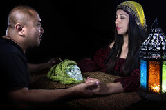 Psychic or a Spirit Medium. Psychic or fortune teller gypsy with a client doing a seance telepathic ritual Royalty Free Stock Images