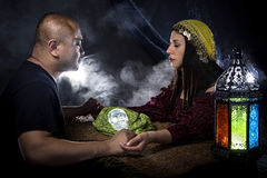 Psychic or a Spirit Medium. Psychic or fortune teller gypsy with a client doing a seance telepathic ritual Stock Images
