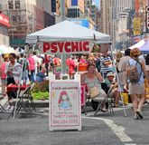 Psychic At A Street Fair. A psychic Reader in a street fair, waiting for customers on 7th avenue in Times Square,Manhattan. NY royalty free stock photos