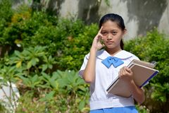Psychic Youthful Asian Person With School Books