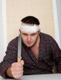 Psycho. Sick crazy man with kitchen knife Stock Photo