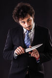 Psycho businessman holding a kitchen knife Stock Photos