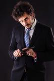 Psycho businessman holding kitchen knife Royalty Free Stock Photography