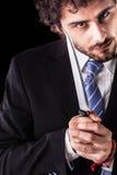 Psycho businessman with kitchen knife Stock Photo