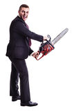 Psycho chainsaw businessman. A young businessman holding a red chainsaw isolated over a white background Stock Photo