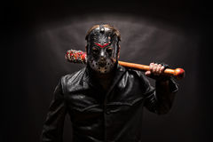 Psycho killer in hockey mask on black background. Stock Photo