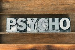 Psycho word tray. Psycho word made from metallic letterpress type on wooden tray Stock Photos