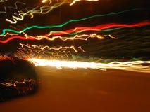 Psychodeliczni światła leją się obok podczas gdy jadący przy nocą Obrazy Royalty Free