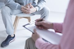 Psycholog bierze notatki obraz stock