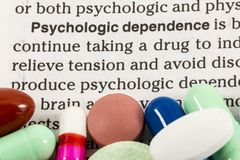 Psychologic dependence drugs. Drug psychological psychologic dependence book article written pills tablets printed page article habit Royalty Free Stock Image
