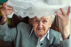 Psychological portrait of an elderly happy woman. Stock Photography